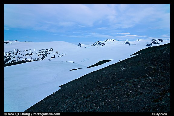 Rocky slope and snow-covered Harding Icefield at dusk. Kenai Fjords National Park (color)