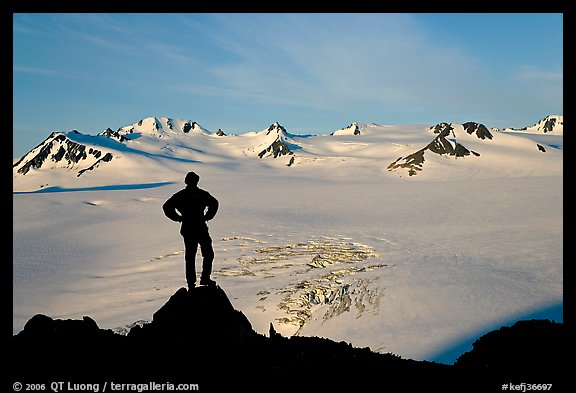 Man standing on overlook above Harding ice field, early morning. Kenai Fjords National Park (color)