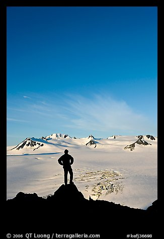Hiker standing on overlook above Harding icefield. Kenai Fjords National Park (color)