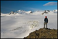 Man looking at the Harding ice field, early morning. Kenai Fjords National Park ( color)