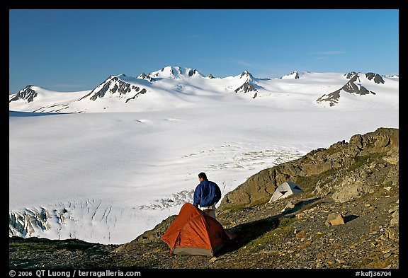 Tent and backpacker above the Harding icefield. Kenai Fjords National Park (color)