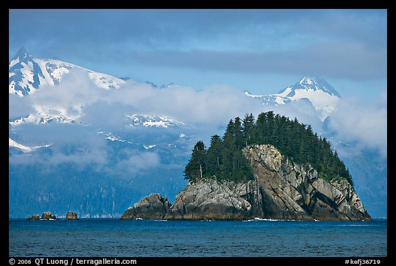 Rocky islet and snowy peaks, Aialik Bay. Kenai Fjords National Park (color)