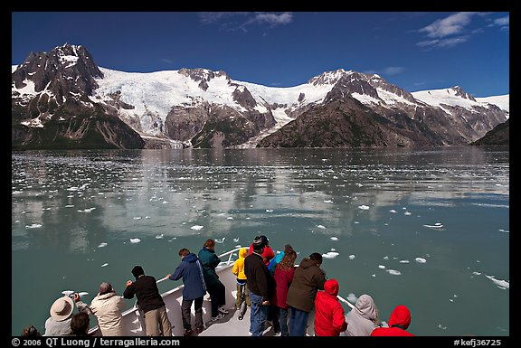 People looking at glaciers as boat crosses ice-chocked waters, Northwestern Fjord. Kenai Fjords National Park (color)