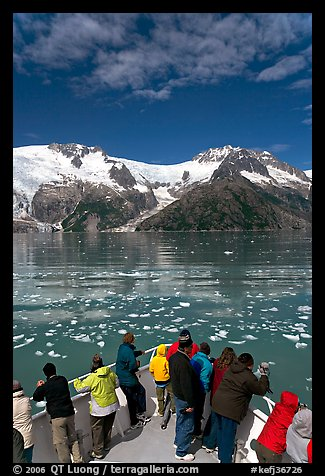 People looking as tour boat slows down for iceberg, Northwestern Fjord. Kenai Fjords National Park (color)