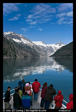 Mountains reflected in fjord, seen by tour boat passengers, Northwestern Fjord. Kenai Fjords National Park (color)