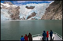 People looking at Northwestern glacier from deck of boat, Northwestern Fjord. Kenai Fjords National Park, Alaska, USA. (color)