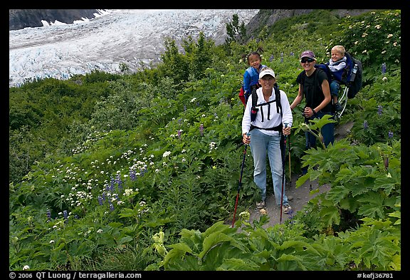 Women carrying infants on trail. Kenai Fjords National Park (color)