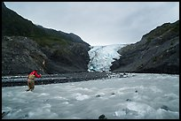 Hiker crosses glacial stream, Exit Glacier. Kenai Fjords National Park ( color)