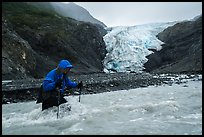 Hiker traverses glacial stream, Exit Glacier. Kenai Fjords National Park ( color)