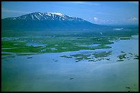 Aerial view of estuary and snowy peak. Lake Clark National Park, Alaska, USA.