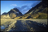Wide gravel river bar below the Telaquana Mountains, sunset. Lake Clark National Park, Alaska, USA.