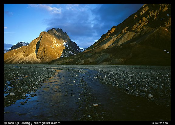 Stream on wide gravel bar and peaks at sunset. Lake Clark National Park (color)