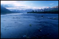 River flowing out of Twin Lakes at sunrise. Lake Clark National Park, Alaska, USA.