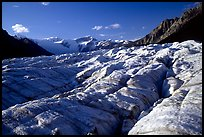 Crevasses on Root glacier, Wrangell mountains in the background, late afternoon. Wrangell-St Elias National Park, Alaska, USA.