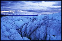 Crevasses on Root glacier at dusk, Chugach mountains in the background. Wrangell-St Elias National Park, Alaska, USA.