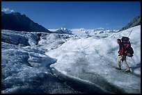 Backpacker on Root glacier. Wrangell-St Elias National Park, Alaska, USA. (color)