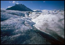 Stream running on surface of Root Glacier and Mt Donoho. Wrangell-St Elias National Park, Alaska, USA.