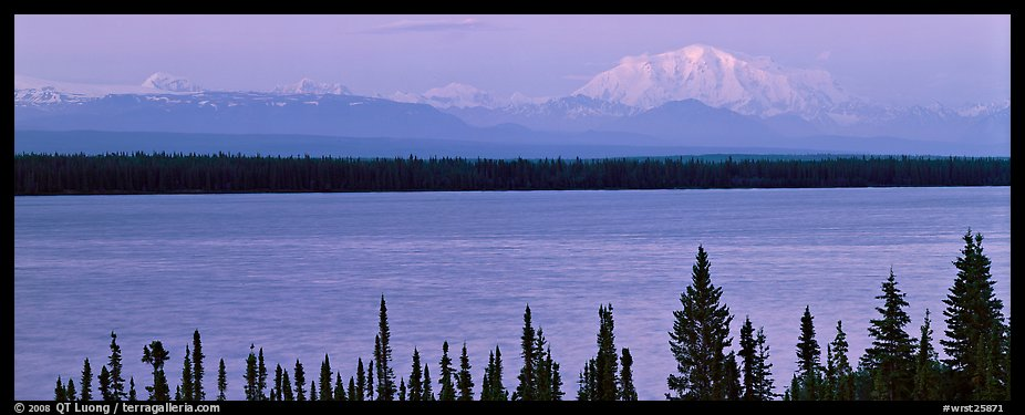 Snowy mountain rising mysteriously above lake. Wrangell-St Elias National Park (color)
