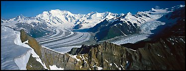 High mountain landscape with glaciers and snow-covered peaks. Wrangell-St Elias National Park (Panoramic color)