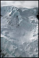 Aerial view of icy face with hanging glaciers and seracs. Wrangell-St Elias National Park, Alaska, USA. (color)