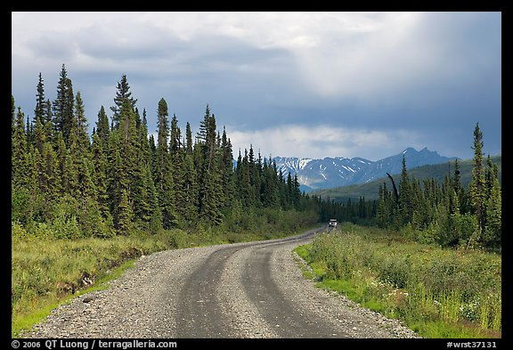 McCarthy road with vehicle approaching in the distance. Wrangell-St Elias National Park (color)