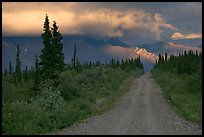 Nabena road at sunset with last light on mountains. Wrangell-St Elias National Park, Alaska, USA. (color)