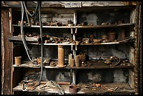 Shelves with equipment, Nabesna Mill. Wrangell-St Elias National Park ( color)