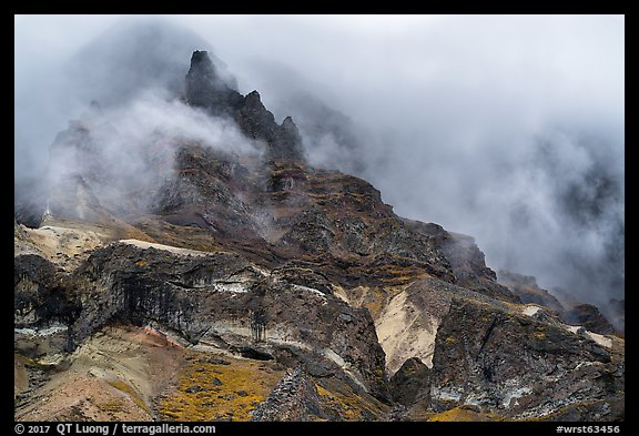 Volcanic spires emerging from clouds, Skookum Volcano. Wrangell-St Elias National Park (color)