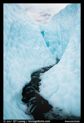 Glacial stream between steep walls of ice, Root Glacier. Wrangell-St Elias National Park (color)