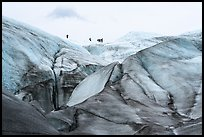 Distant hikers on Root Glacier from below. Wrangell-St Elias National Park ( color)