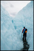 Hiker in narrow canyon, Root glacier. Wrangell-St Elias National Park ( color)