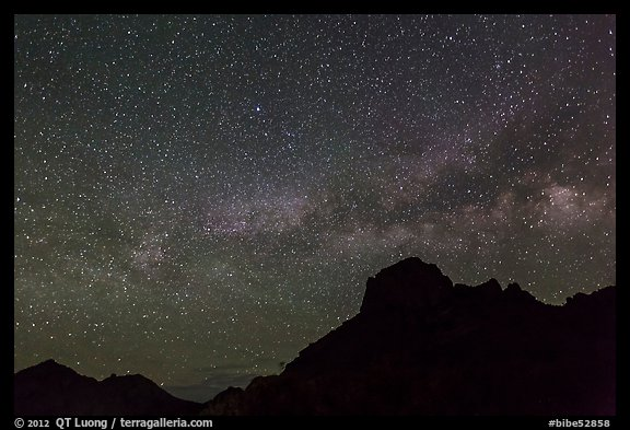 Starry sky and Milky Way above Chisos Mountains. Big Bend National Park (color)