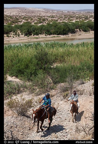 Mexican horsemen from Boquillas Village. Big Bend National Park (color)