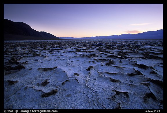 Evaporation patterns on salt flats near Badwater, dusk. Death Valley National Park, California, USA.