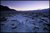 Evaporation patterns on salt flats near Badwater, dusk. Death Valley National Park, California, USA. (color)
