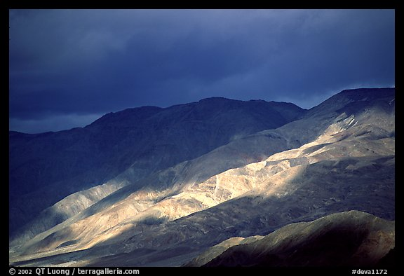 Storm light on foothills. Death Valley National Park (color)