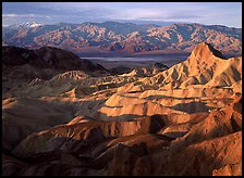Badlands, Valley, and Telescope Peak from Zabriskie Point, winter sunrise. Death Valley National Park, California, USA.