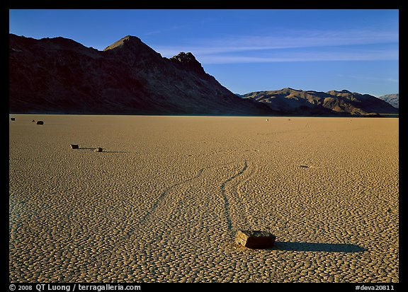 Tracks, moving stone on Racetrack playa and Ubehebe Peak, late afternoon. Death Valley National Park (color)