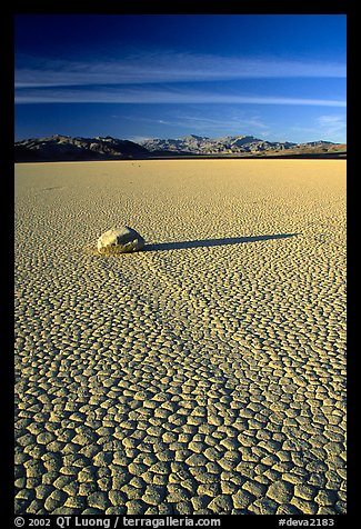 Tracks, sliding stone on the Racetrack playa, late afternoon. Death Valley National Park (color)