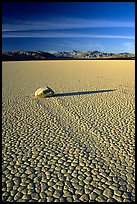 Tracks, sliding stone on the Racetrack playa, late afternoon. Death Valley National Park, California, USA. (color)