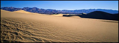 Landscape of sand dunes and mountains. Death Valley National Park (Panoramic color)