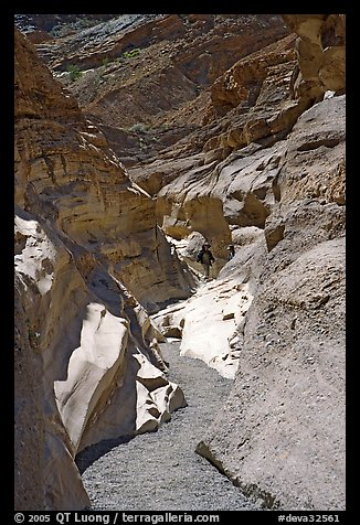 Hikers in slot, Mosaic canyon. Death Valley National Park (color)