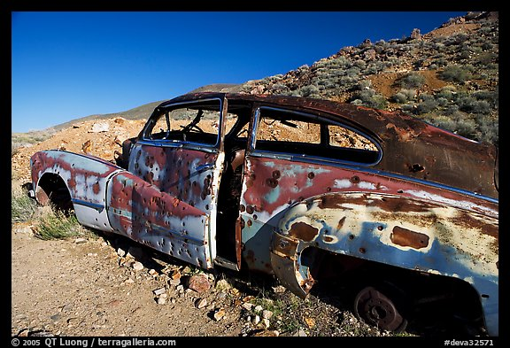 Car with bullet holes near Aguereberry camp, afternoon. Death Valley National Park (color)