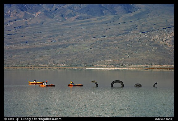 Kayakers approaching the dragon in the rare Manly Lake. Death Valley National Park (color)