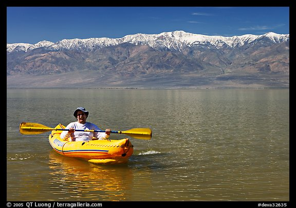Kayaker padding ephemeral Manly Lake. Death Valley National Park (color)