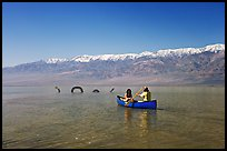 Canoe near the dragon in Manly Lake, below the Panamint Range. Death Valley National Park, California, USA. (color)