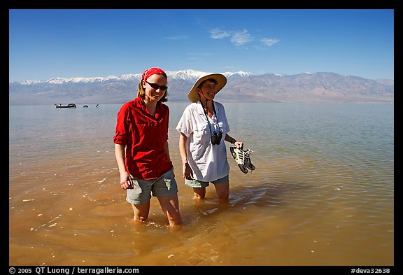 Women wading in the knee-deep seasonal lake. Death Valley National Park (color)