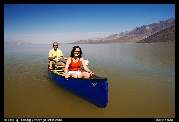 Canoists in rarely formed Manly Lake with Black Mountains in the background. Death Valley National Park (color)