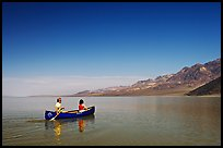 Canoeing on the ephemerald Manly Lake with Black Mountains in the background. Death Valley National Park, California, USA. (color)