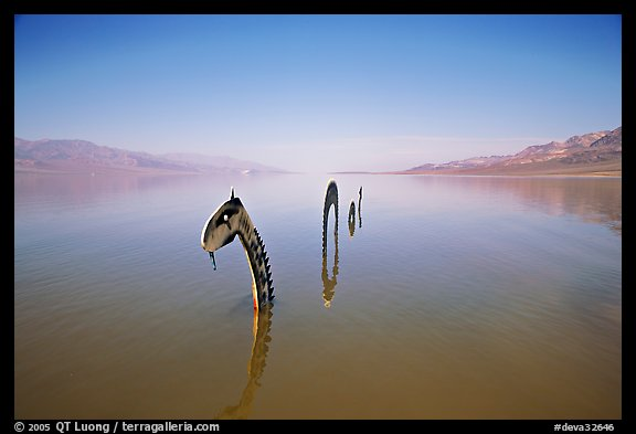 Loch Ness Monster art installation in rarissime seasonal lake. Death Valley National Park (color)